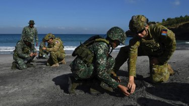 Australian Army Sapper Nicholas Field and Lance Corporal Callum Leete instruct Philippine marines during training at Marine Base Gregorio Lim.