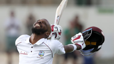 Roston Chase celebrates a century against England.