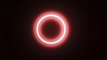 An annular solar eclipse is seen though safety glass from Siak, Riau province, Indonesia.