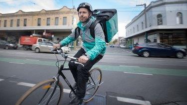 Levi Aron on his Deliveroo bike.