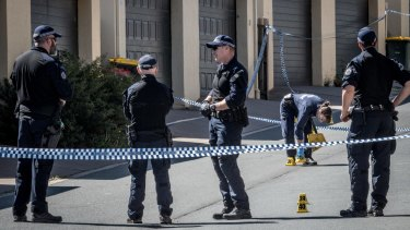 Police investigating at the scene of the alleged murder.