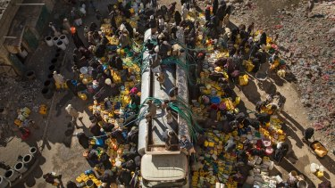 A water truck provides limited water supplies to residents in the Amran governorate in Yemen in March.