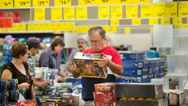 Customers inspecting products in Aldi's special buys including a cordless drill.