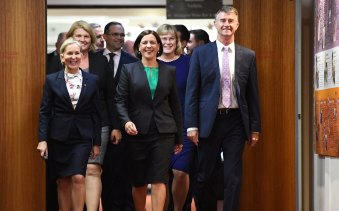 Deb Frecklington (centre) and her  deputy Tim Mander (right) walking in to a 2017 party room meeting that saw their elevations.