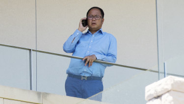 Chinese political donor Huang Xiangmo on the balcony of his Mosman mansion last year.