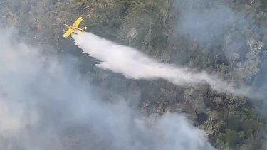 Water-bombing efforts against the Fraser Island bushfire on Friday, November 27.