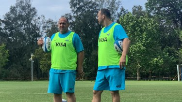 Mario Ledesma and Michael Cheika run their eye over Argentina training on Tuesday.
