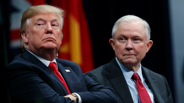 President Donald Trump sits with Attorney-General Jeff Sessions during the FBI National Academy graduation ceremony in Quantico, Virginia, in December.