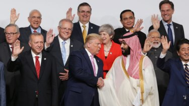 US President Donald Trump shakes hands with Saudi Crown Prince Mohammed bin Salman at the G20 in Osaka in June.