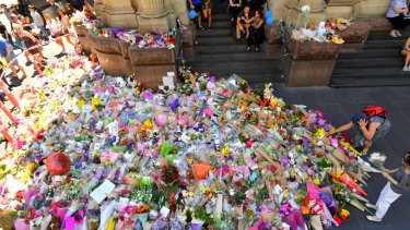 The huge pile of flowers in Bourke Street in the aftermath of the tragedy.