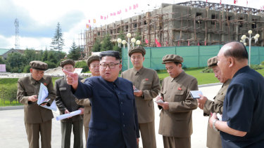 Kim Jong-un, centre, visits a construction site during a visit to the city of Samjiyon.
