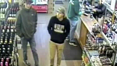 Missing Belgian backpacker Theo Hayez, center, wearing black hooded jumper, inside liquor store in Byron Bay.