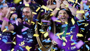 Evergreen: Smith and Billy Slater with the NRL Premiership Trophy in 2017.