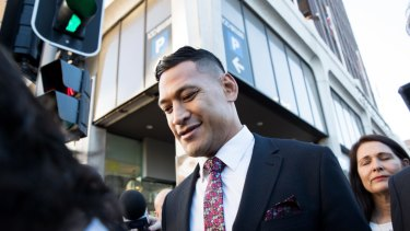 Israel Folau leaves a conciliation hearing at the Fair Work Commission.