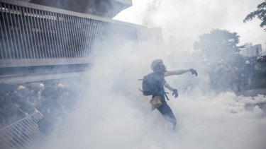 A protester obscured by clouds of tear gas in Hong Kong on Wednesday.