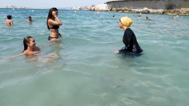 Nesrine Kenza enjoys swimming in her burkini in Marseille, France, in 2016.