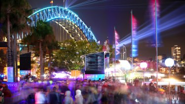 Crowds take in Vivid Festival on Sydney Harbour.