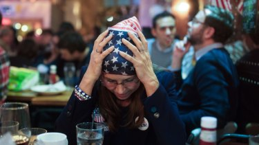 A Democratic Party supporter watches 2016 election results come in.