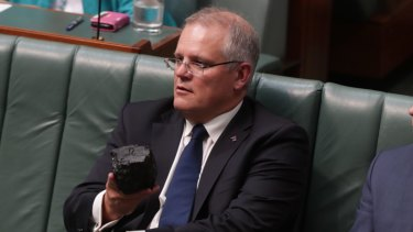 Prime Minister Scott Morrison with a lump of coal during Question Time at Parliament House in 2017.