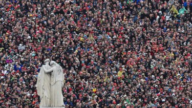 People listen during the inaugural address by President Donald on January 20, 2017.