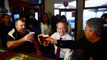 Bill Shorten has a beer with Beaconfield Mine survivors Todd Russell and Brant Webb shortly after launching his 2016 election campaign.