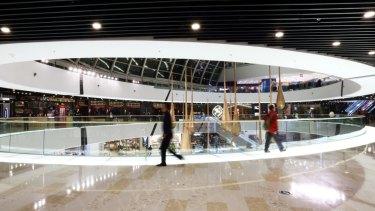 Shoppers at the Tongzhou Wanda Plaza shopping centre, operated by Dalian Wanda Group, in Beijing.