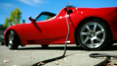 A Tesla Roadster being charged.