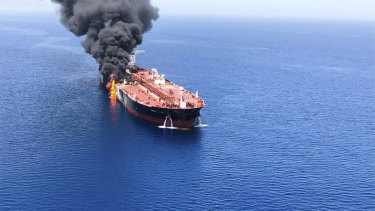 An oil tanker is on fire in the sea of Oman.