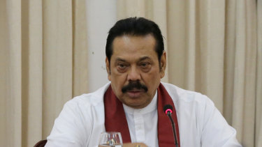 Sri Lanka's then appointed prime minister Mahinda Rajapaksa speaks to members loyal to him at his office in Colombo, Sri Lanka in November.