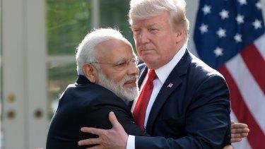 President Trump and Indian Prime Minister Narendra Modi hug outside the White House.