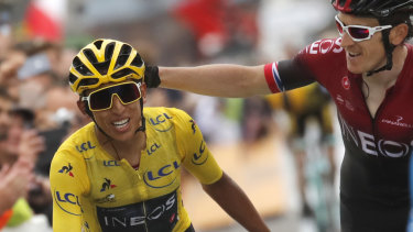 Britain's Geraint Thomas, right, congratulates this year's champion,  Colombian Egan Bernal.