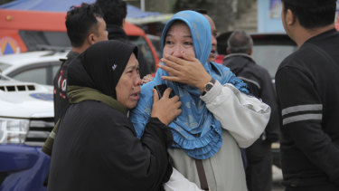 Relatives weep at Tigaras port after learning that their family members were among the passengers on the ferry that sank on Monday.