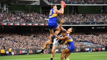 Jeremy McGovern flies high in last year's Grand Final for one of his more memorable intercept marks.