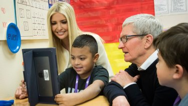 Apple CEO Tim Cook, right, and Ivanka Trump on their schools tour.
