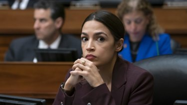 Alexandria Ocasio-Cortez listens to questioning of Michael Cohen, President Donald Trump's former personal lawyer.