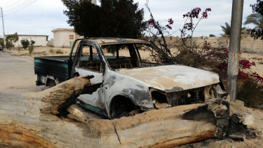 A burned truck is seen outside al-Rawda Mosque in Sinai, Egypt a day after attackers killed hundreds of worshippers in November, 2017.