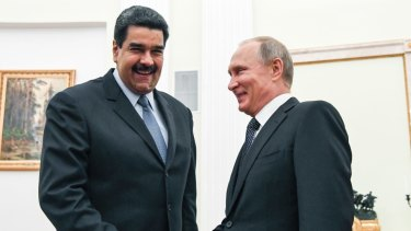 Russian President Vladimir Putin, right, shakes hands with Venezuela's President Nicolas Maduro in Moscow in October 2017.