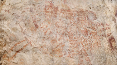 A composite image from the book Borneo, Memory of the Caves shows the world's oldest figurative artwork in a limestone cave in Borneo. Scientists say the red silhouette of a bull-like beast, upper left, is the oldest known example of animal art.