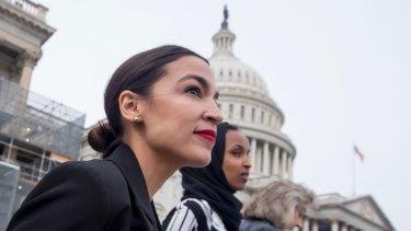 Rep. Alexandria Ocasio-Cortez wearing her signature red lipstick.