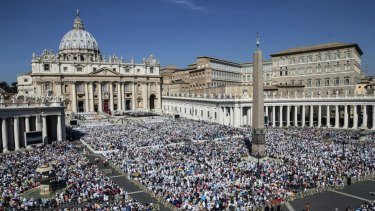 St Peter's Square is crowded with thousands of faithful attending a canonisation mass by Pope Francis.