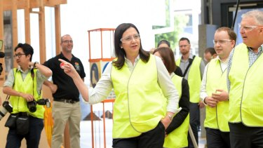 Queensland Premier Annastacia Palaszczuk (centre) visits the TAFE Skill Centre at Acacia Ridge in 2017.