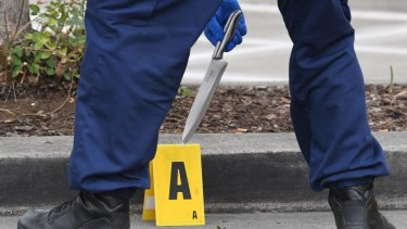 Police retrieve a knife from a crime scene near Bonnyrigg High School.