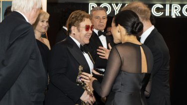 The Duke and Duchess of Sussex with Elton John at the European Premiere of Disney's The Lion King.