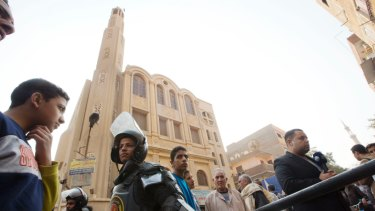 Policemen surround Mar Mina church, in Helwan, Cairo, Egypt, where at least 10 people, including eight Coptic Christians, have been killed in a shootout outside the church.