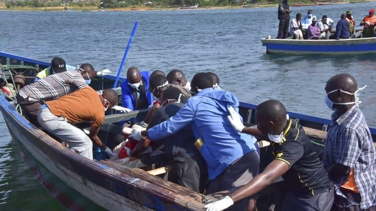 Rescuers retrieve a body from the water near Ukara Island in Lake Victoria, Tanzania.