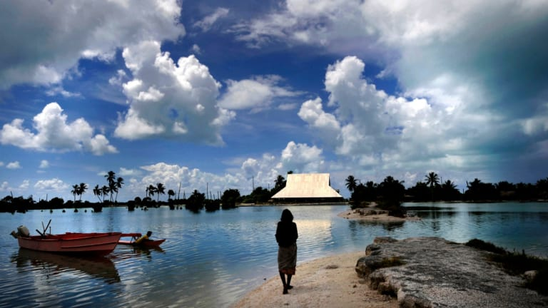 Low-lying Pacific nations such as Kiribati are battling rising sea levels as a result of climate change.