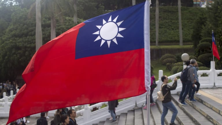 Cross-strait propaganda has a long history: A Taiwan flag stands at the National Palace Museum in Taipei, Taiwan.