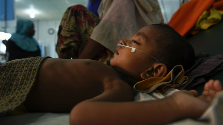 Jomil aged 2 lays unconscious whilst being treated for fever and breathing problems at the Medecins Sans Frontieres hospital in Kutupalong Camp. Kutupalong & Balukhali camps combined are the worlds largest refugee camp, home to approximately 400,000 of the 900,000 Rohingya who fled Myanmar.
