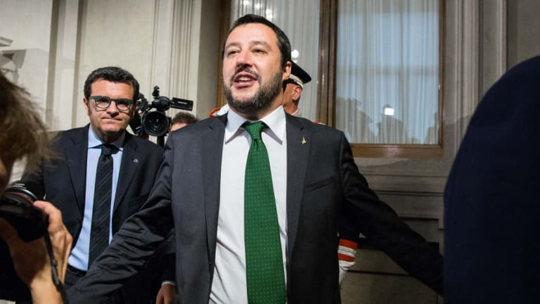 The rise of anti-migration populists like Italy's Matteo Salvini, centre, and the budget crisis in Rome, are seen by the EU as existential challenges.