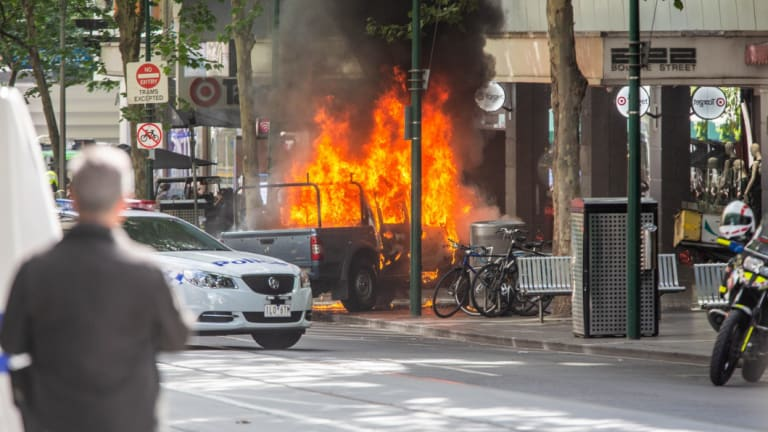The first reports of the Bourke Street attack were of a vehicle on fire.